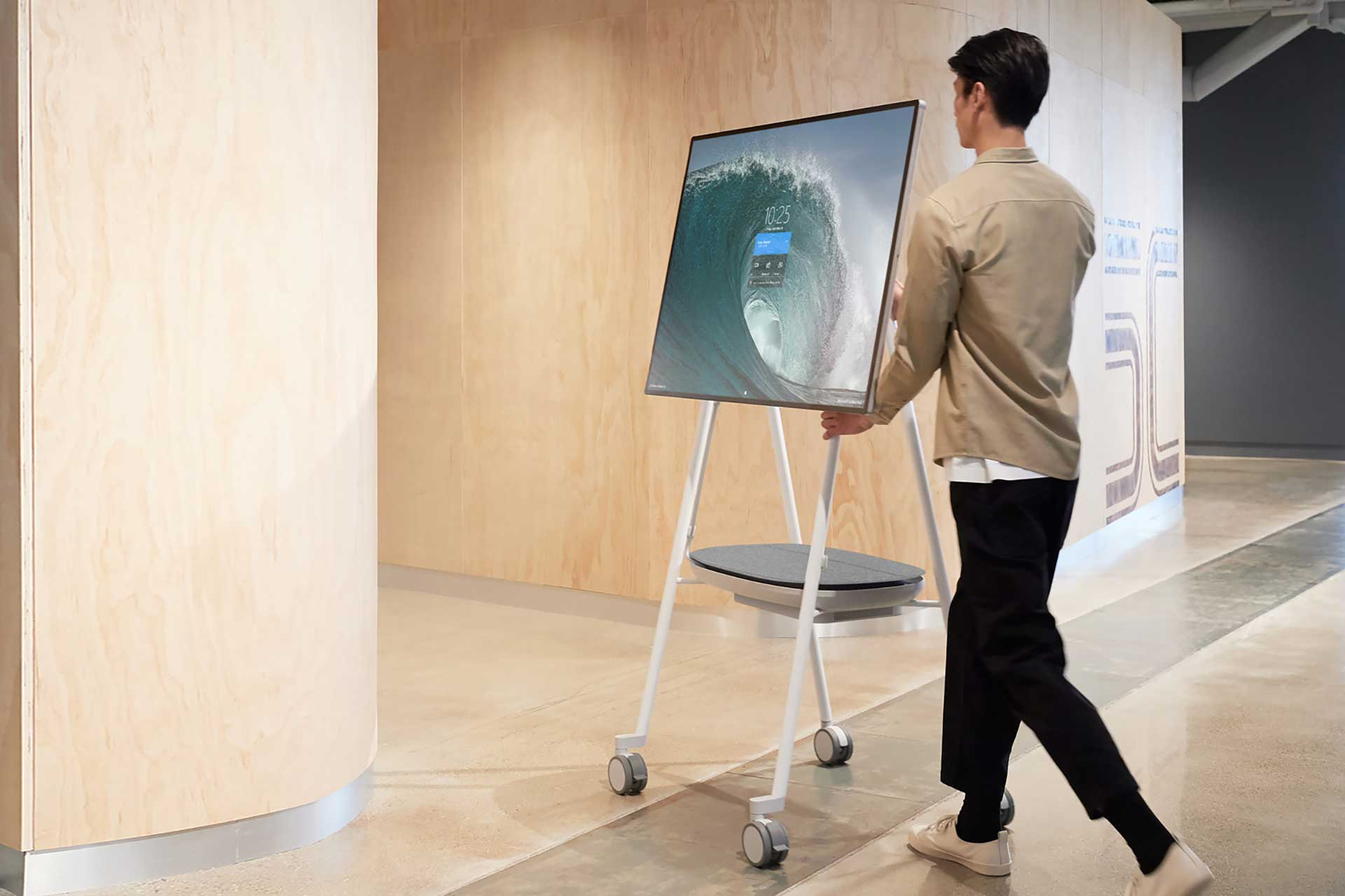 worker transports surface hub between rooms