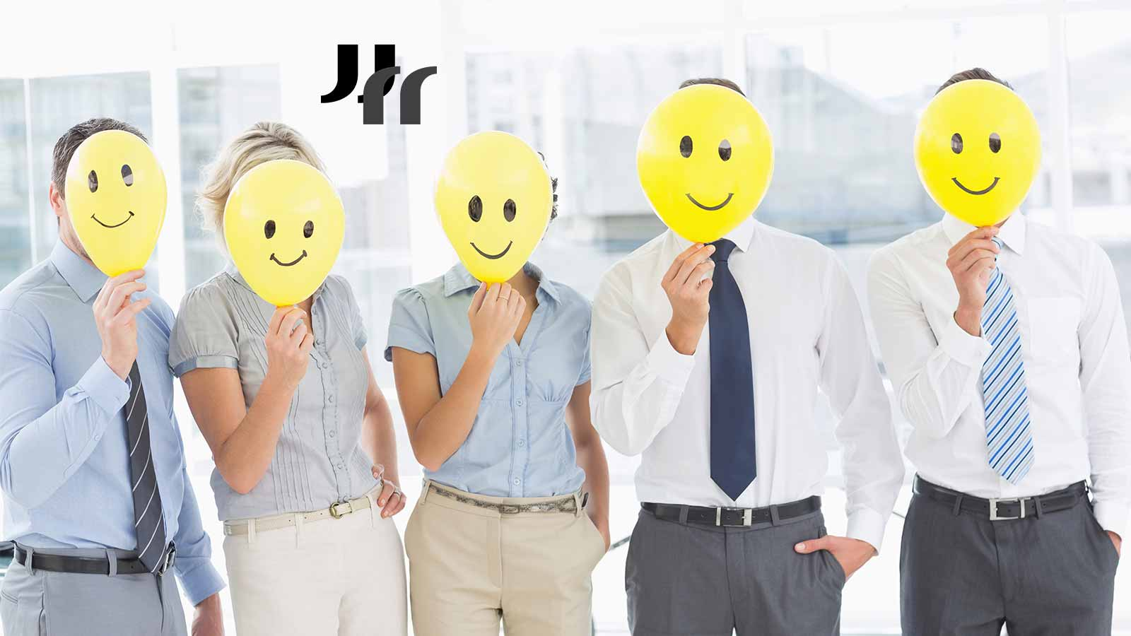 image of 5 people in dress shirts and slacks holding yellow smiley face balloons in front of their faces